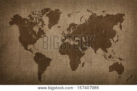 Brown world map on old vintage darkened grunge flax linen fabric textile sackcloth bagging canvas with stains