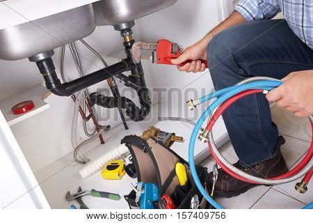 Plumber On The Kitchen.