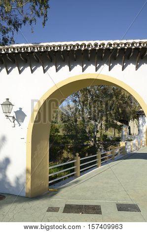 The mountain through an arch of a little bridge in Marbella Spain.