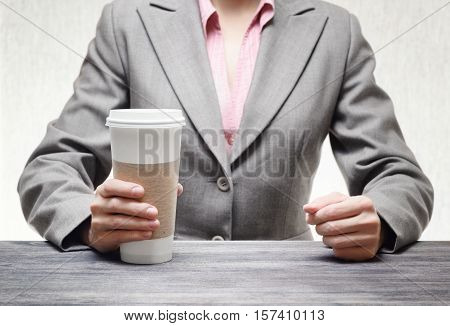 Business Woman With A Tumbler Of Coffee
