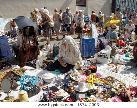 MOSCOW, RUSSIA - July 31, 2016: Flotsam and jetsam of a flea market and their buyers and sellers on a hot day. July 31, 2016 in Moscow, Russia