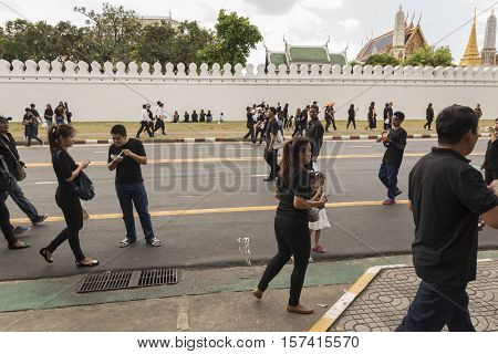 BANGKOK THAILAND - OCT 23 : snap shot of people at Sanam Chai road on the way to Sanam Luang while the funeral of king Bhumibol Adulyadej in Grand Palace on october 23 2016