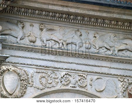 Siena - beautifully decorated frieze on the façade of Palazzo Publicco