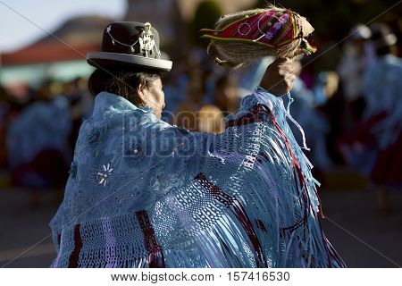 Aymara woman dancing at the Festival of the Virgen del Rosario in Chucuito. October 16, 2012 - Chucuito, Puno, Peru.