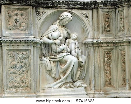 Madonna and Child . Panel of the Fonte Gaia (Fountain of Joy) Piazza del Campo Siena.