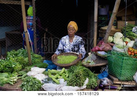 Indonesian woman selling fresh vegetables at the market in Semarang. January 9 2014 - Java Indonesia