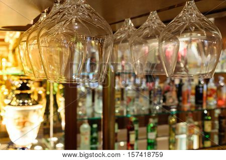 Whiskey glass defocus on Bottles of whiskey at the bar background process in soft orange sun light style