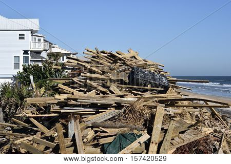 VILANO BEACH, FLORIDA, USA - OCTOBER 22, 2016: Aftermath of hurricane debris on the beach caused by hurricane Matthew hitting along the east coast of Florida on October 7, 2016.