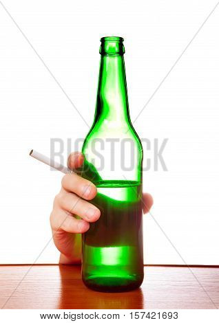 Person hold the Beer and Cigarette at the Table on the White Background