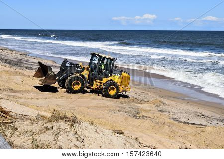 VILANO BEACH, FLORIDA, USA -  OCTOBER 19, 2016: Heavy construction equipment clearing beach debris caused by hurricane Matthew hitting the east coast of Florida on October 7, 2016.