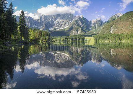 Alpine lake Sunrise over the alpine lake