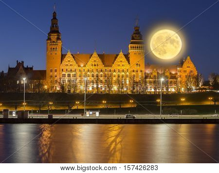 night panorama of the city of Szczecin in Polandfull moon