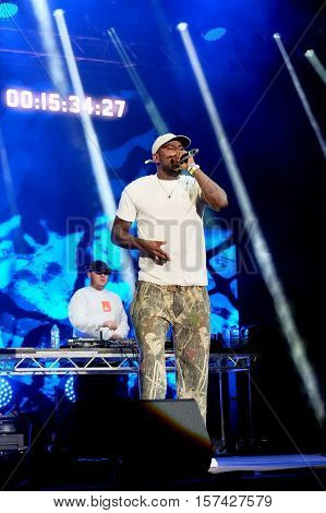 NEWPORT, ISLE OF WIGHT, UK - SEPTEMBER 9 2016: British rapper and grime artist Joseph Junior Adenuga AKA Skepta performing live on the main stage at Bestival, Newport, Isle of Wight