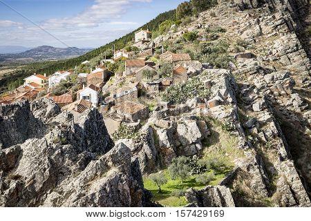 a view of Penha Garcia village on a rocky hill, Idanha-a-Nova, district of Castelo Branco, Portugal