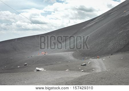 Volcano boarding is a super fun activity for adventurous travelers. Cerro Negro Volcano near Leon Nicaragua. Shallow DOF