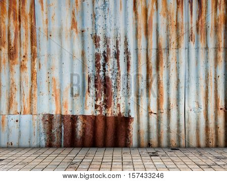 Rusted galvanized iron plate with tile floor