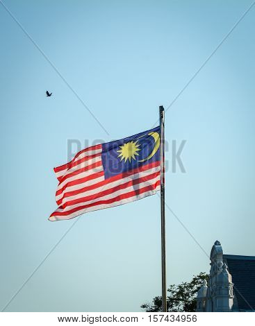 Malaysia Flag Waving On The Blue Sky