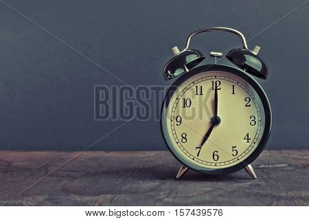 It's Seven O'clock Already, Time To Wake Up For Breakfast, Vintage Old Black Metallic Alarm Clock