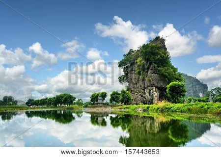 Beautiful Natural Karst Tower Reflected In The Ngo Dong River