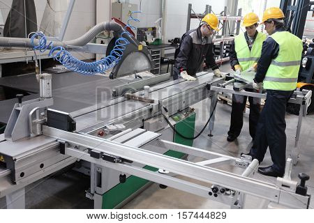 CNC machine shop with lathes technicians and workers