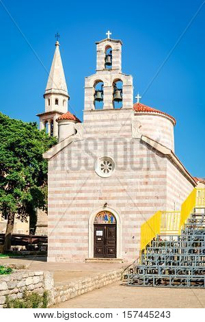 Construction of Church of Holy Trinity in Budva was finished in 1804. It has a bell loft with three bells and a dome. Its facade is decorated with a rosette above the western door. The iconostasis of this church is the work of Greek iconographers from the