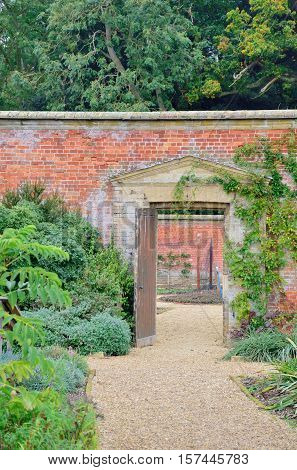 door and path in traditional english walled garden