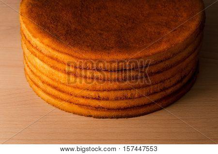 Fresh round shortcakes closeup on wooden background