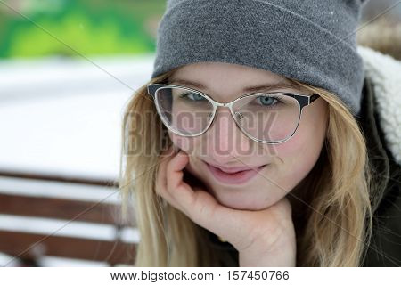 Smiling Teen On Bench