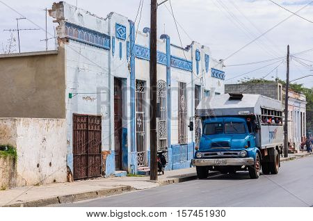 CIENFUEGOS, CUBA - MARCH 22, 2016: Old truck serving as public transport for local people in Cienfuegos Cuba