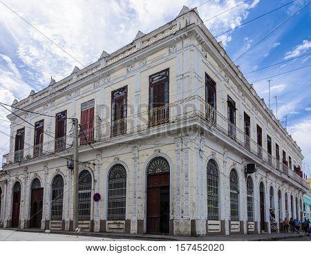 CIENFUEGOS, CUBA - MARCH 22, 2016: Colonial building in a street corner in Cienfuegos Cuba