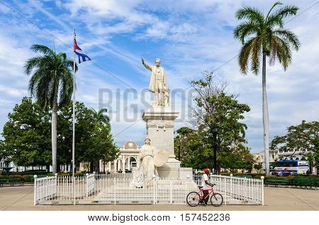 CIENFUEGOS, CUBA - MARCH 22, 2016: Jose Marti Statue in the park holding his name the UNESCO World Heritage main square of Cienfuegos Cuba