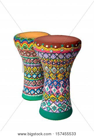 Front view of two colorful painted goblet drums (also chalice drum tarabuka darbuka debuka doumbek dumbec dumbeg dumbelek toumperleki or tablah) single head membranophone with a goblet shaped body used mostly in the Middle East North Africa South Asia and