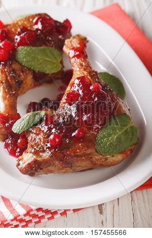 Festive Food: Baked Duck Leg With Cranberry Sauce And Mint Closeup. Vertical