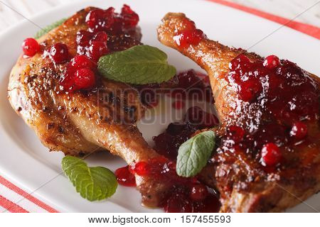 Roasted Duck Leg With Cranberry Sauce And Mint Closeup. Horizontal