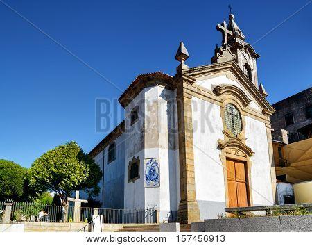 The Church of Santa Marinha in the Vila Nova de Gaia in Porto on the blue sky background. Porto is one of the most popular tourist destinations in Europe.