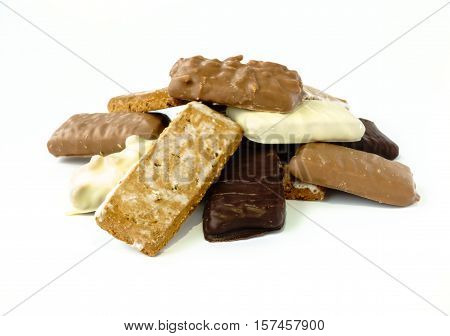 Closeup of different varieties of Aachener Printen a type of Lebkuchen isolated on white background.