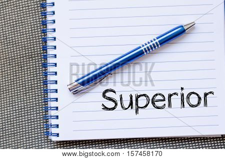 Superior text concept write on notebook over dark background