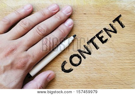 Human hand over wooden background and content text concept