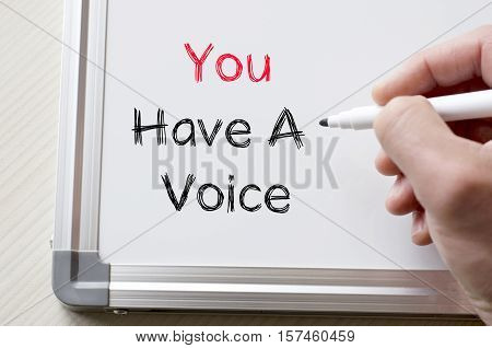 Human hand writing you have a voice on whiteboard