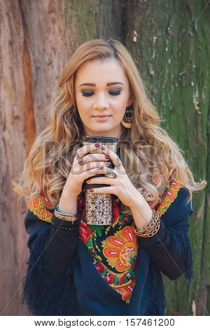 Winter portrait of a hippie young woman