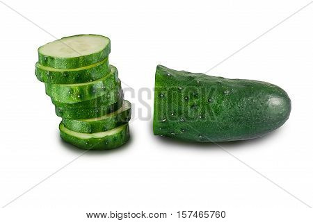 Рalf of cucumber and slices of cucumber on white background