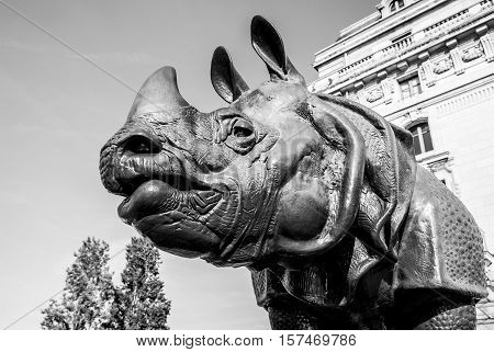 PARIS FRANCE - 02 SEPTEMBER 2015: Black-white photo of rhinoceros statue in front of museum D'Orsay in Paris France.