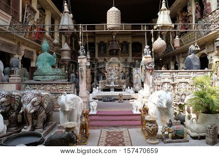 JAIPUR, INDIA - FEBRUARY 16: Shop selling Indian antiques and reproductions among a plethora of shops for tourists in Jaipur, Rajasthan, India on February 16, 2016.