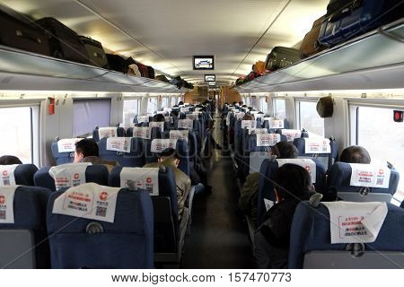 CHINA - FEBRUARY 22: Interior of busy economy carriage on new Beijing to Shanghai high-speed railway in China on February 22, 2016.