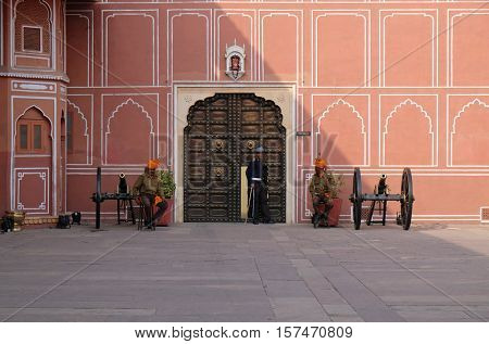 JAIPUR, INDIA - FEBRUARY 16: Guard and cannons in Jaipur City Palace, a palace complex in Jaipur, Rajasthan, India. It was the seat of the Maharaja of Jaipur, the head of the Kachwaha Rajput clan