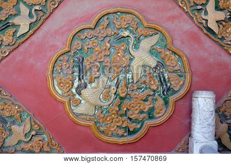 BEIJING - FEBRUARY 23:  Ceramic detail from Royal Palace wall in The Forbidden City, Beijing, China, February 23, 2016.
