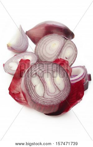 Sliced red onion on a white background