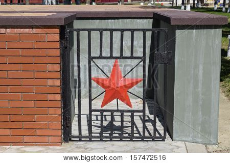 Red Five-pointed Star That Adorns The Steel Gate. The Steel Door In An Underground Room Under The Mo