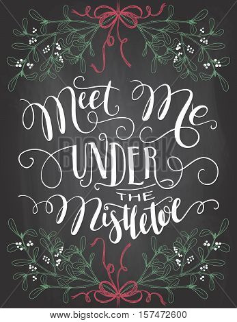 Meet me under the mistletoe. Brush calligraphy on blackboard background with chalk. Christmas chalkboard typography