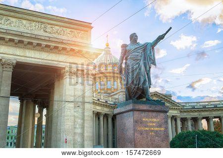 ST PETERSBURG RUSSIA - OCTOBER 3 2016. Monument to Field Marshal Prince Mikhail Kutuzov and Kazan Cathedral in St Petersburg Russia - architecture landscape view of St Petersburg landmark